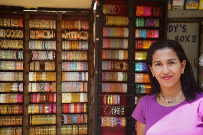Shobha Narayan in front of a street store. Commercial Street.